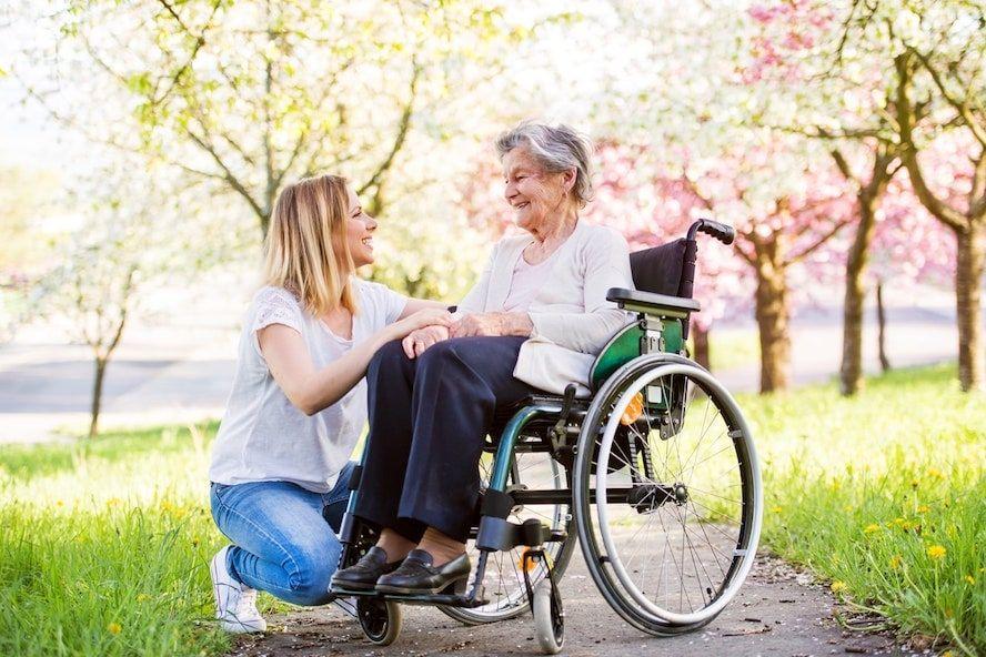 Elderly grandmother using a rented wheelchair - Cloud of Goods