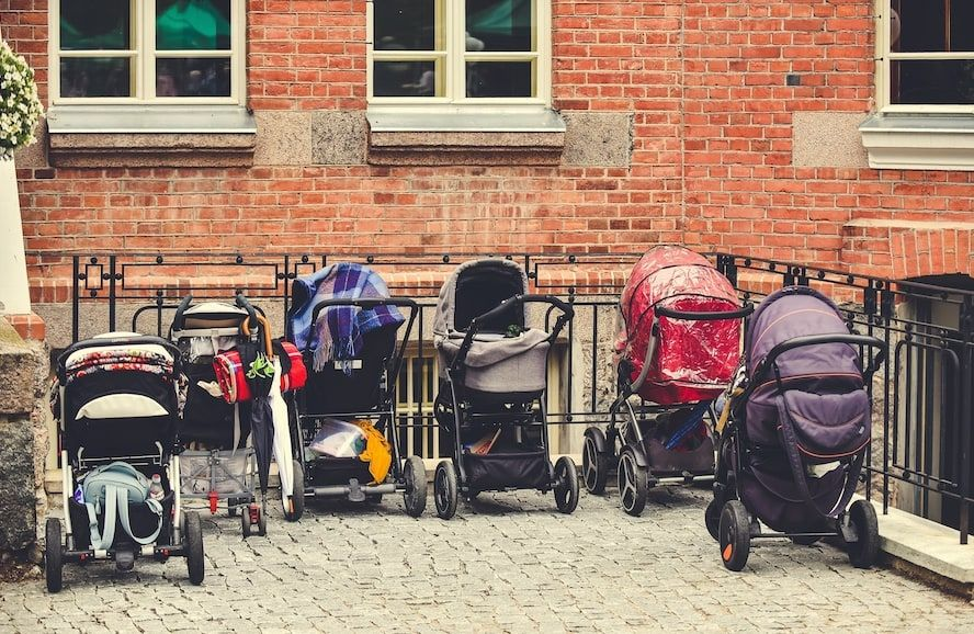 Baby strollers on a sidewalk to be rented  - Cloud of Goods