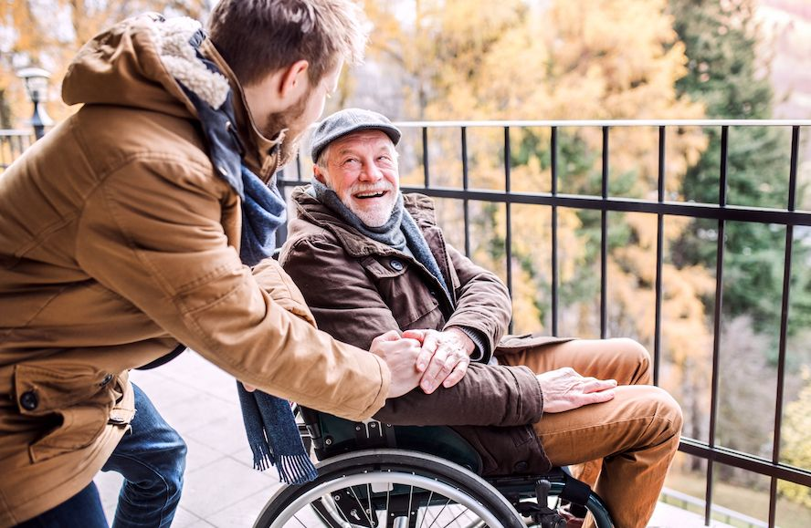 Smiling senior on wheelchair is very happy - Cloud of Goods