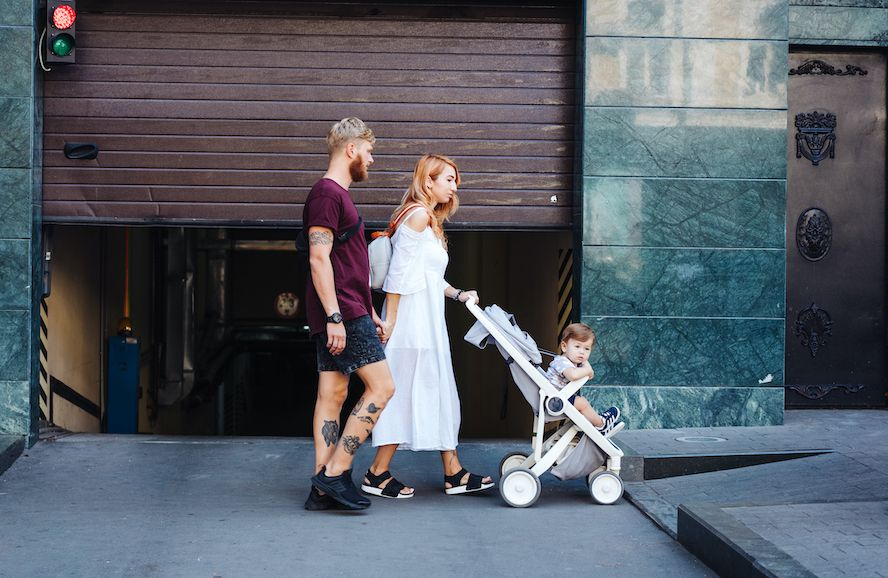 man and woman with a stroller - Cloud of Goods